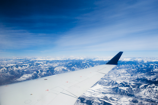 flying-over-snow-covered-mountain