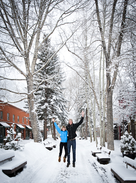 young-couple-jumping-snow
